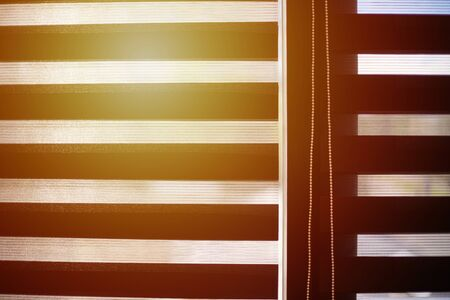 Office blinds. Sunlight through modern fabric blinds. Office meeting room lighting range control.