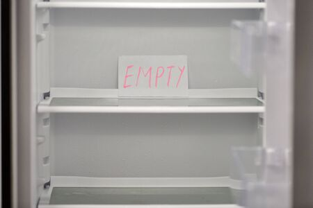 Empty refrigerator concept. Empty shelves of new refrigerator. Weight loss diet concept. Stockfoto