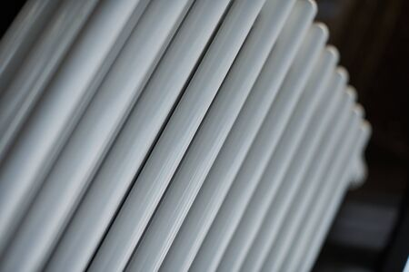Heating radiator in office, close up. White heat exchangers. Iron aluminium steam radiator. Pipe pattern. 스톡 콘텐츠