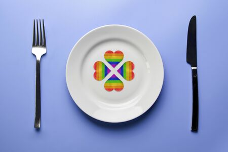 LGBT flag hearts in plate. Romantic gay dating in cafe or restaurant. Meeting new lgbt friends. Stock fotó