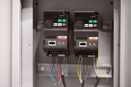 Ventilation control switch in office. Automatically operated electrical switch in fuse box. Standard-Bild