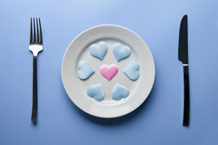 Hearts on plate. Woman and men love flirt. Stock Photo