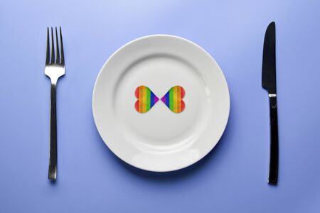Two hearts in LGBT flag colors in plate.