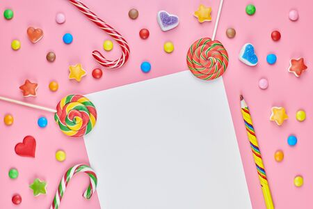 Blank page in sweet candy and sweetmeats. Sweet dreams list concept. Making a shopping list for child for birthday, Christmas or other holiday