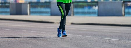 Running woman. Fitness woman jogging in sportswear on city road. Healthy lifestyle, sport hobby. Street workout, sprinting outdoor Imagens