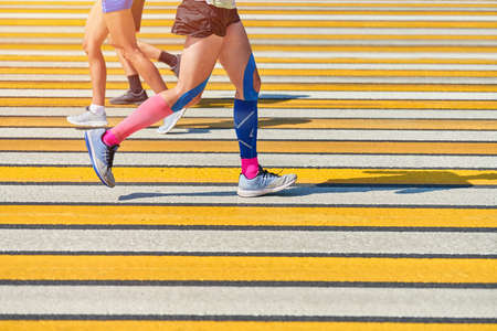 Man running crosswalk, copy space. Athletic man jogging in sportswear on city road. Healthy lifestyle, fitness sport hobby. Traffic violation. Street workout, sprinting outdoor