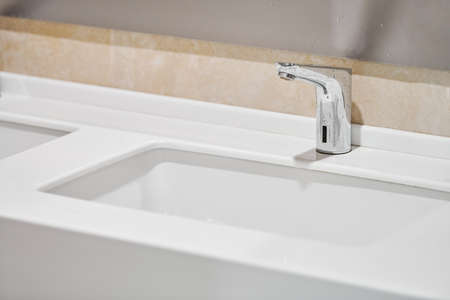 Faucet in bathroom interior. Water tap for washing hands. Sanitary prevention antivirus concept.