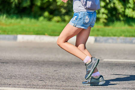 Running woman. Fitness woman jogging on city road. Healthy lifestyle, sport hobby. Street workout, sprinting outdoor Imagens