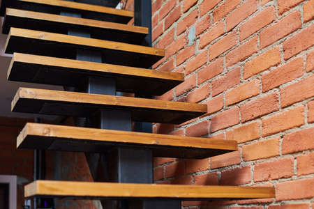 Stairs in loft apartment. Staircase without railing. Modern hipster style attic loft apartment details. Imagens