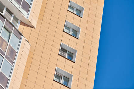Multistorey building. Rhythm in photography. Multi-storey facade, windows and block of flats, close up. Modern apartments in high raised building. Angle perspective. Imagens