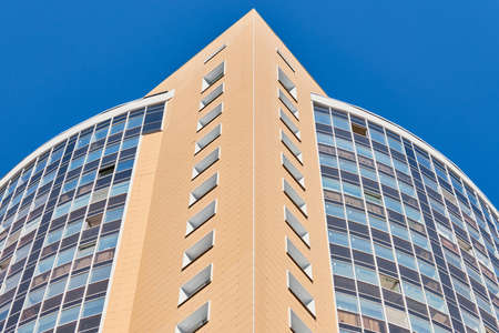 Multistorey building. Rhythm in photography. Multi-storey facade, windows and block of flats, close up. Modern apartments in high raised building. Angle perspective. Editorial