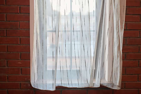 Window curtains in loft apartments. Translucent white curtains in modern bedroom, copy space.