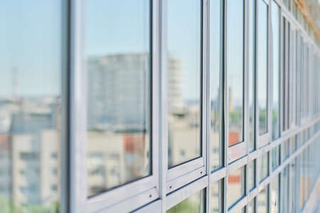 PVC windows on facade of skyscraper. Plastic double glazed windows. Building exterior.