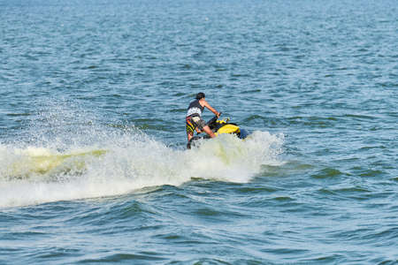 Man on water scooter. Summer vacation on personal watercraft in tropical sea. Young guy sea riding hobby. PWC sport activity