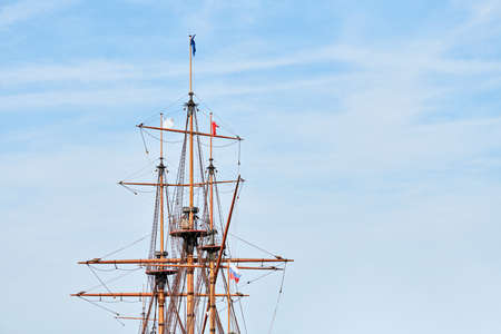 Sailing mast of ship, copy space. Sailing vessel main topgallant mast with crows nest. Old frigate warship