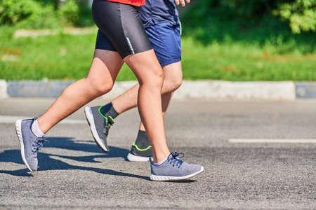 Running men. Sport men jogging in sportswear on city road. Healthy lifestyle, fitness hobby. Street marathon race sprinting outdoor