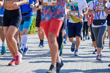 Voronezh, Russia - 08.24.2019 - Marathon runners on city road. Running competition, copy space. Street sprinting outdoors. Healthy sport event. Editorial