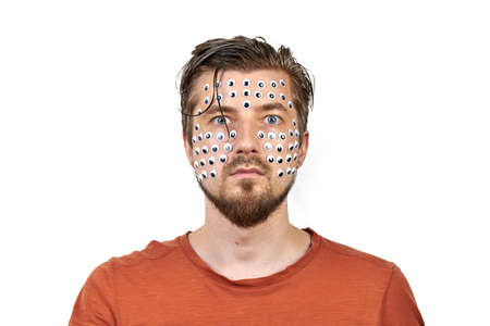 Funny man with many eyes on face. Insect vision performance art concept. Weird freaky man portrait emotion, white isolated background. Strange and unusual facial expression Stockfoto