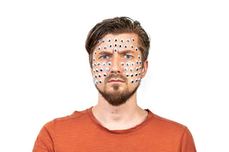 Funny man with many eyes on face. Insect vision performance art concept. Weird freaky man portrait emotion, white isolated background. Strange and unusual facial expression