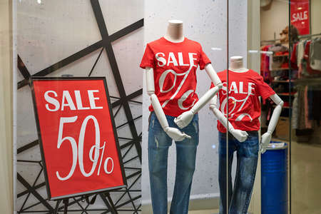 Seasonal super sale 50% off, holiday discount in shopping mall. New Year's sale time at european shopping center. Black Friday. Christmas promotions in clothing store. Stock fotó