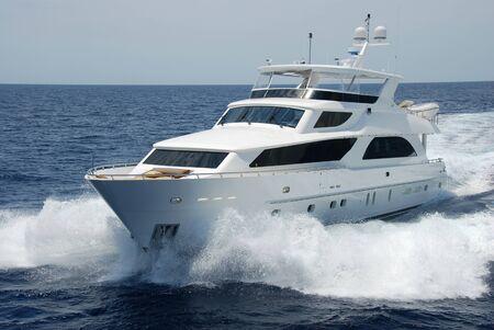 Luxury yacht running left
