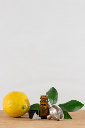 Lemon Essential Oil Bottle With Black Cap, Citrus Leaves and Funnel