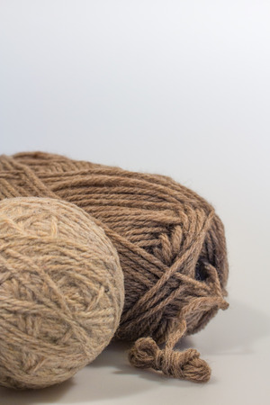 needlecraft: Dryer Ball and Wool Yarn in Vertical Format with White Space