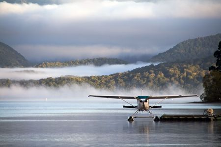A landed waterplane - in the foggy hills photo