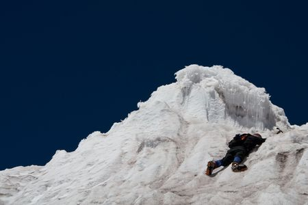 a climbing woman sliped and is hanging on the edge of an ice cliff