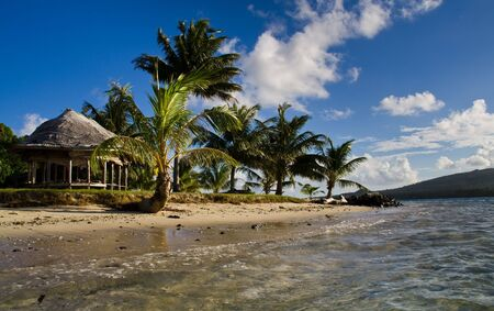 a view at the island huts of an island in the south sea Stock Photo