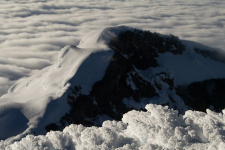 view of a neighbour summit at a high mountain Stock Photo