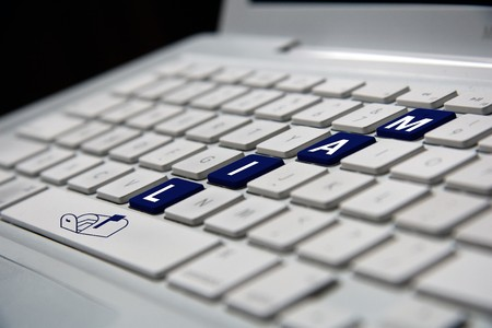 white notebook keyboard with blue mail letters photo