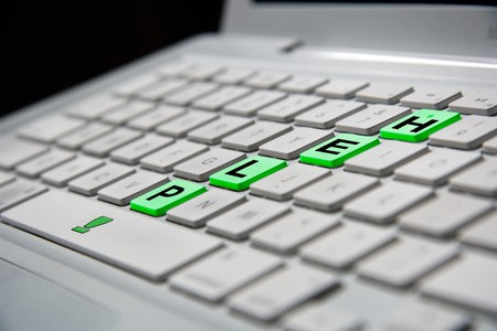 white notebook keyboard with green help letters
