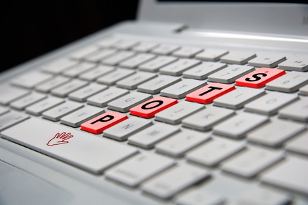white notebook keyboard with red stop letters