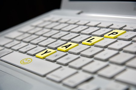 white notebook keyboard with yellow play letters photo