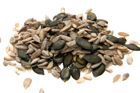 isolated sunflower and pumpkin seeds on a pile