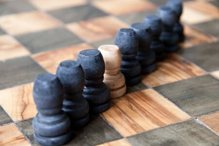 a row of chess pawns on the board
