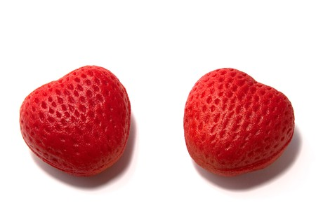 two isolated strawberry hearts on white background