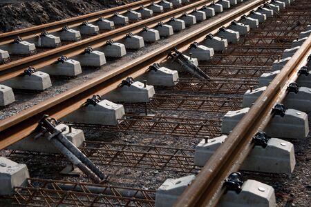 construction of a iron railway track through the city Stock Photo