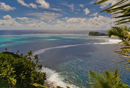 panorama view with palm trees and a tropical island photo