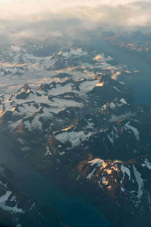 Flying over Greenland at sunrise