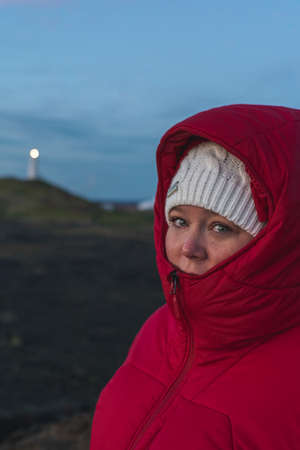 face closeup of a woman wearing a red jacket