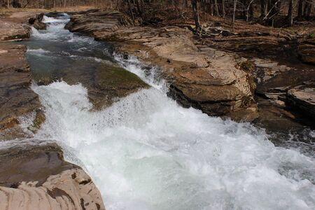 rushing water: rocks cause rushing water