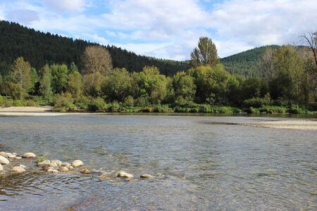 Sunny mountain stream Banco de Imagens