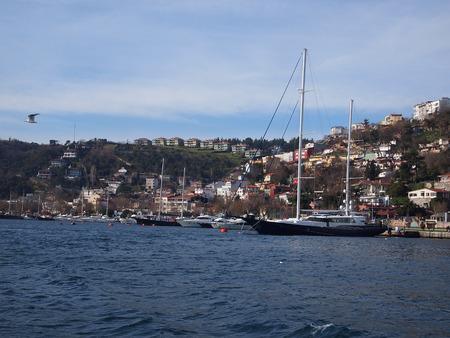 strait: Boat on Bosphorus Strait Stock Photo