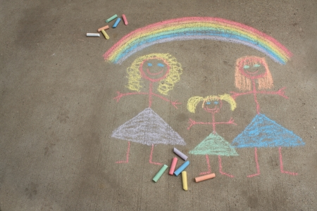 lesbian women: Concept image for gay parenting or gay marriage a chalk child