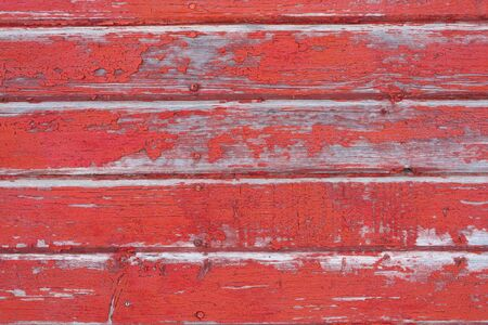 A background image of peeling red paint on old barn boards Stock Photo - 16815571