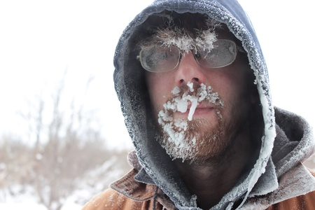 hoary: A close up image of a man with frosted glasses and facial hair on a cold, overcast winter day  Stock Photo