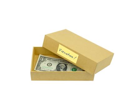 public celebratory event: money savings in cardboard box isolated on white backgdround. Travel budget.