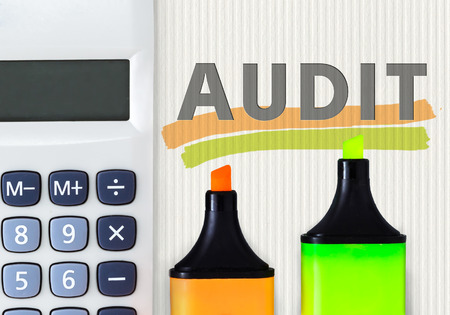 reassessment: Audit business abstract concept. Calculator with highlighters Stock Photo